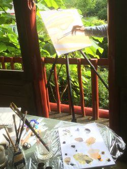 painting en plein air in a pagoda in the dorset countryside