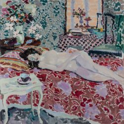 nude laying on a bed with muted palette of textiles and pattern